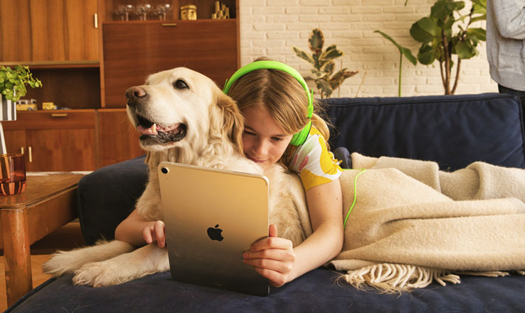 Child & dog watching tablet