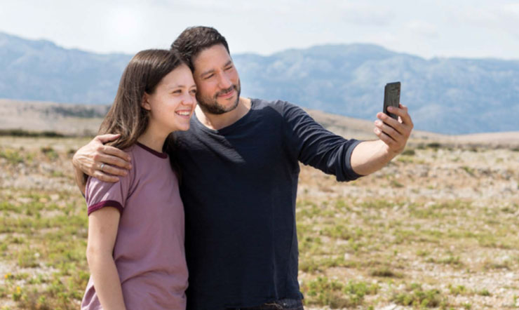 Dad taking a selfie with daughter